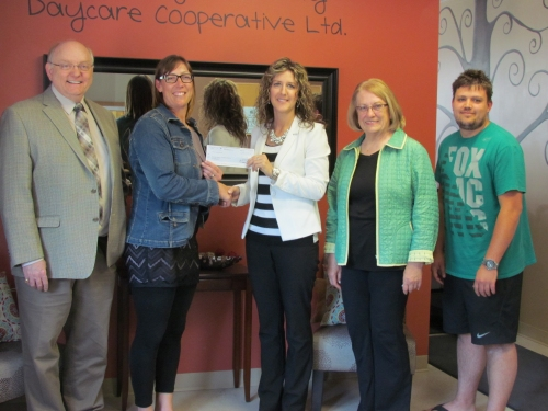 L-R: Roy Spence - CEO, GM NVCU. Aimee Unchulenko - Chair, Board of directors, Esterhazy Community Daycare Co-operative. Allison Tymiak - AVP, Strategic Relationship Management, Concentra Financial. Donna Overland - President, Board of Directors, NVCU. Noel De Beer, the daycare's Executive Director.