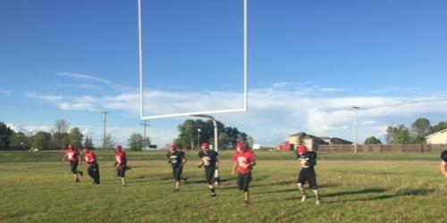 ESTERHAZY:- Alumni Warrior Football players smiling ear to ear